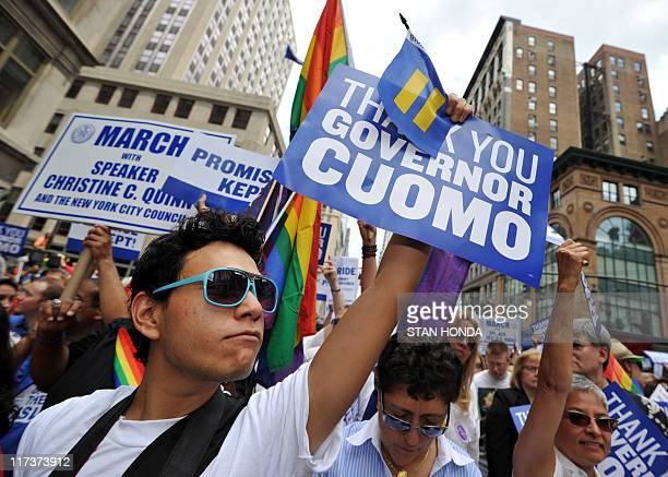 A man holds a sign thanking New York State Governor Andrew Cuomo during the New York City gay pride march June 26 2011 The New York state legislature...