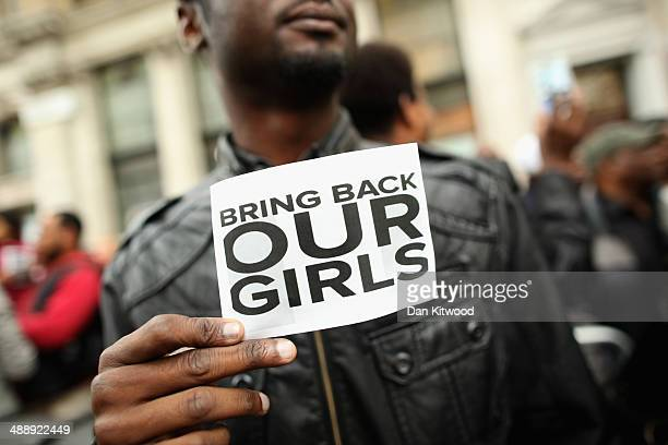 A man holds a sign that reads 'Bring back our girls' during a protest outside Nigeria House on May 9 2014 in London England 276 schoolgirls were...