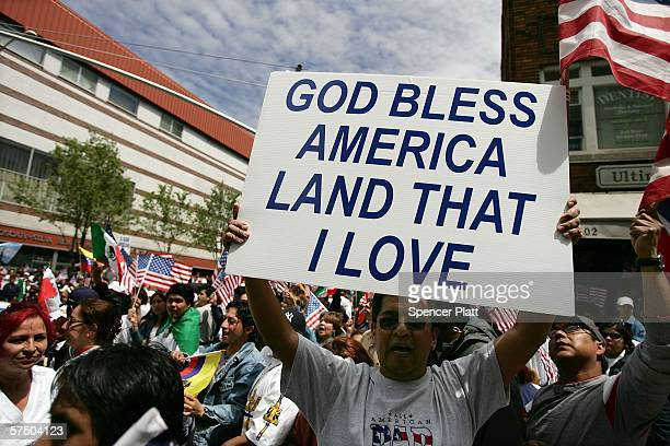 A man holds a sign which reads God Bless America Land That I Love as he and others participate in a proimmigrant demonstration May 1 2006 in the...