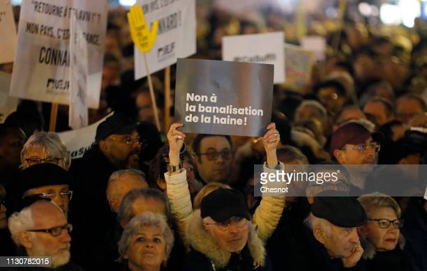 """Man holds a sign which reads """"No to the trivialization of hatred"""" as he takes part in a rally against anti-Semitism on the Republic Square on..."""