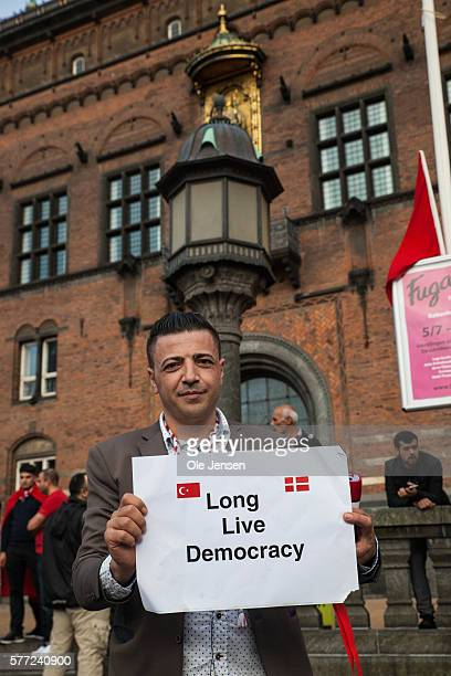 A man holds a sign with the text Long Live Democracy during the support demonstration for President Erdogan at Copenhagen City Hall Square in Denmark...