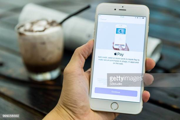 A man holds a smart phone with Apple Pay application is displayed on July 13 2018 in Hong Kong Hong Kong