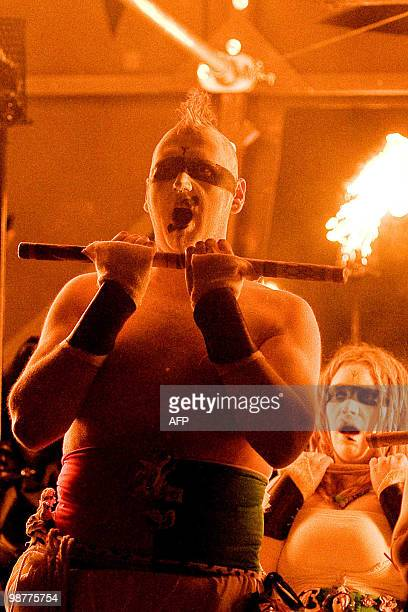A man holds a torch as he performs during the Beltane Fire Festival in Edinburgh on April 30 2010 The event which celebrates an ancient Celtic...