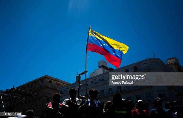 A man holds a Venezuelan flag during a demonstration against government politics and the increase in public services fees at Social Development...