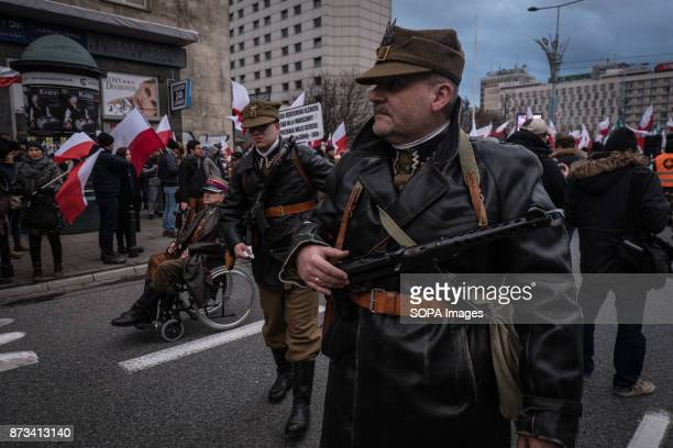 Man holds a weapon as thousands gather for the annual nationalist march of Poland´s Independency Day Poland's Independence Day is a annual day to...