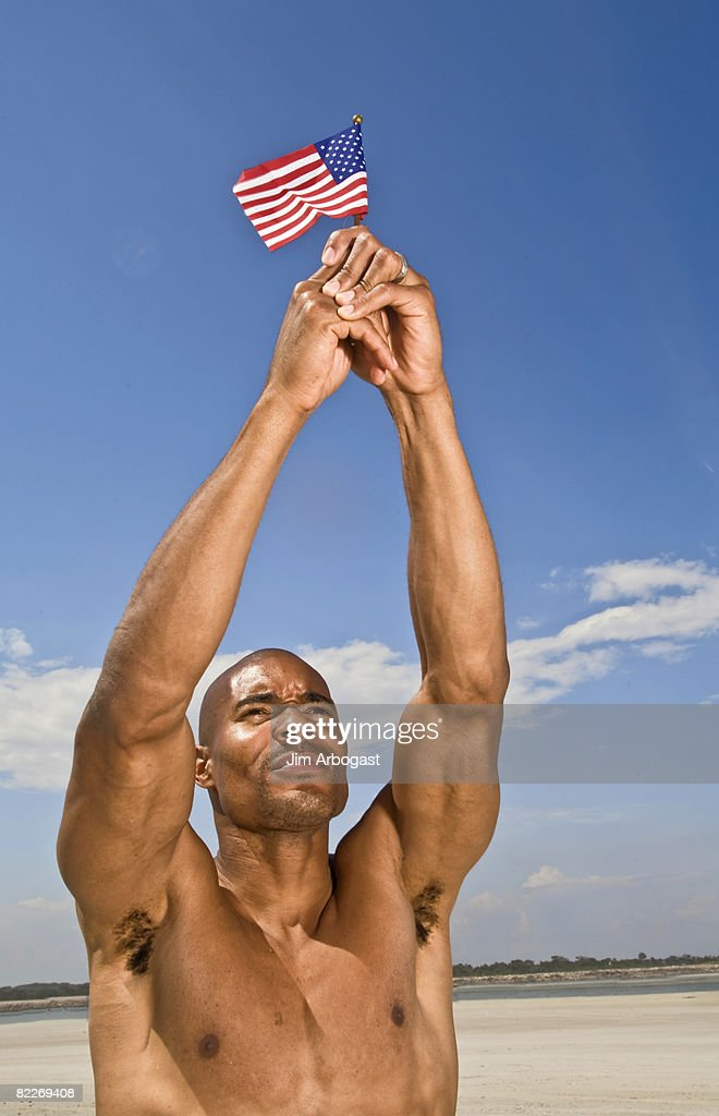 Man holds American Flag.  : Stock Photo