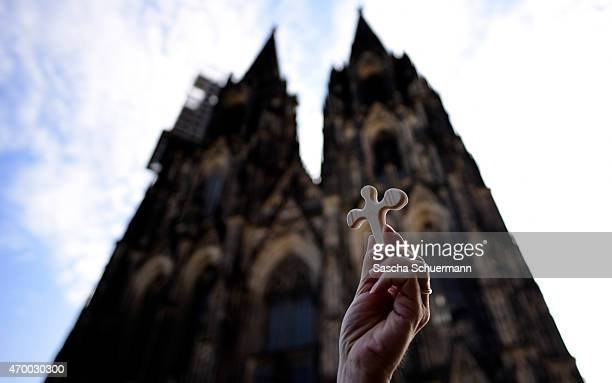 Man holds an abstract angel figurine, which be distributed for a memorial service to commemorate the victims of the Germanwings flight 4U9525...