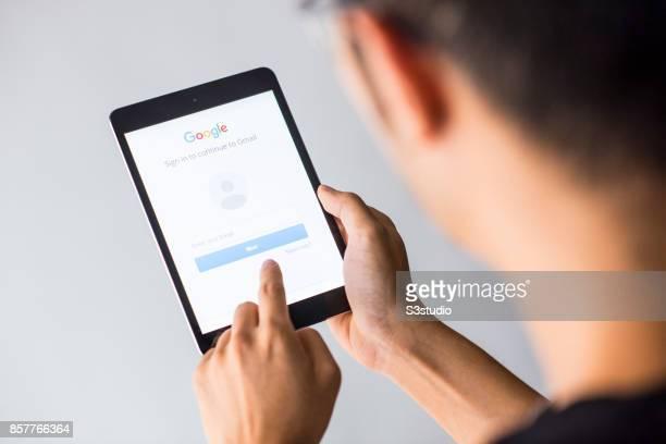 A man holds an Apple iPad Mini as he uses Google app on October 4 2017 in Hong Kong Hong Kong