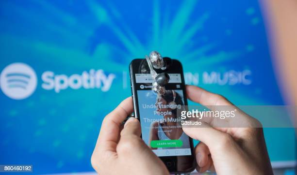 A man holds an Apple iPhone5S as he uses Spotify app on October 11 2017 in Hong Kong Hong Kong