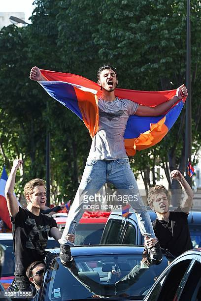 A man holds an Armenian flag during a march in commemoration of the 101th anniversary of the mass killings of Armenians by Ottoman forces in 1915 on...