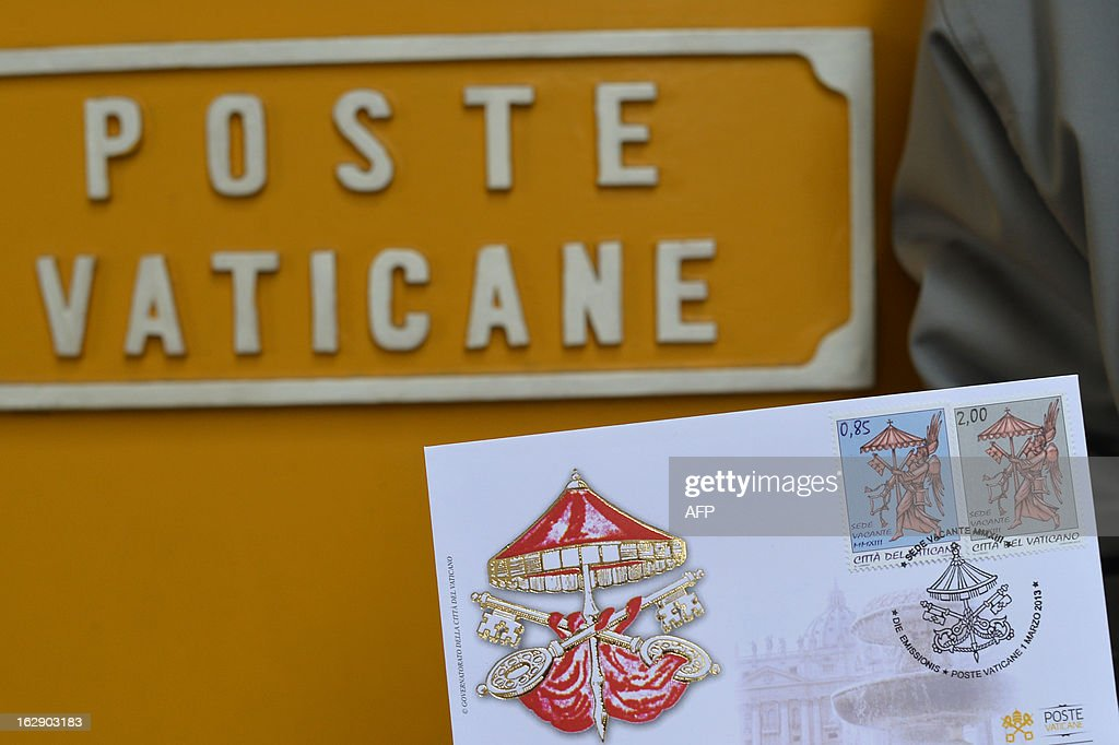 A man holds an enveloppe with the stamps for use during the 'Sede Vacante', or Vacant See, created by the historic resignation of pope Benedict XVI, on the day they were issued on March 1, 2013 at the Vatican. The unusual interregnum stamps, a series of four, include the Vacant See symbol -- a striped umbrella over crossed keys -- as well as the words Sede Vacante, Citta del Vaticano and MMXIII, the year in Roman numerals.
