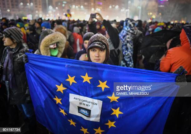 Man holds an EU flag during a protest against the Justice minister and the corruption in the front of the Romanian Government in Bucharest on...