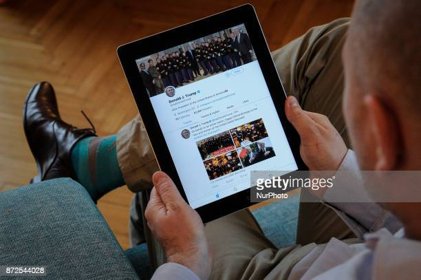 A man holds an iPad with Donald Trump's Twitter feed visible on November 10 2017