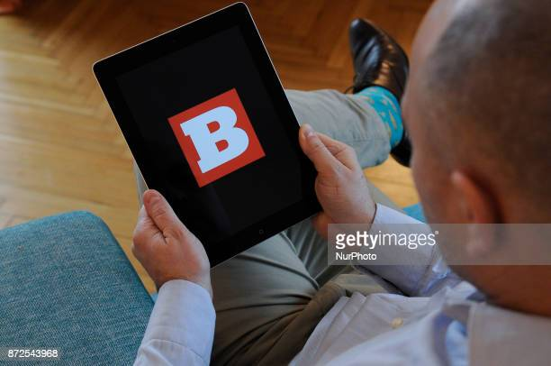 A man holds an iPad with the Breitbart logo on it's screen on November 10 2017