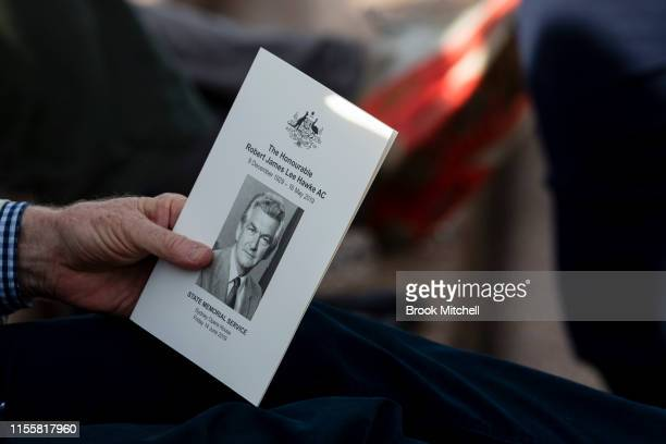 A man holds an order of service card at the Memorial for Bob Hawke at the Sydney Opera House on June 14 2019 in Sydney Australia Robert James Lee...