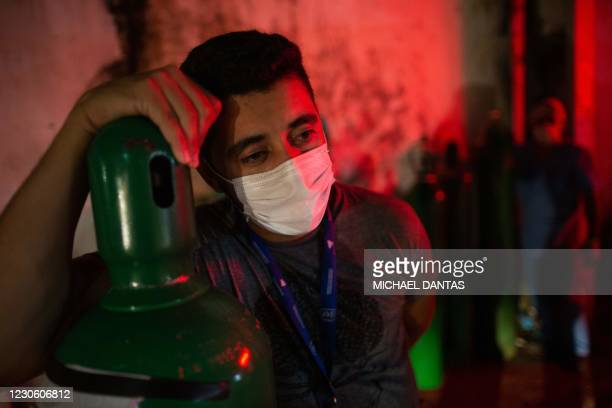 Man holds an oxygen tank in Manaus, Amazonas State, Brazil, on January 15 amid the COVID-19 ovel coronavirus pandemic. - The health system in Manaus,...