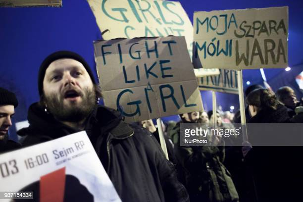 A man holds banner during strike against restrictions in Abortion Law in Warsaw on March 23 2018