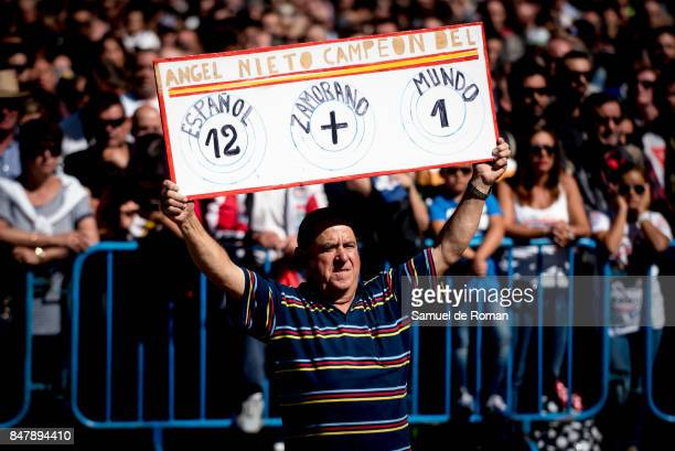 A man holds banner during the Funeral Tribute For Angel Nieto in Madrid on September 16 2017 in Madrid Spain