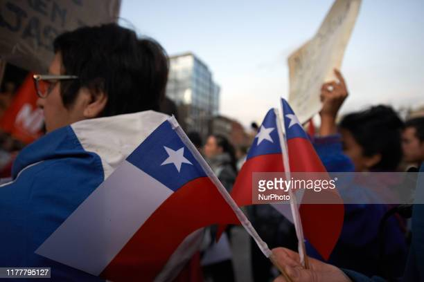 A man holds Chile' flags Toulouse' Chileans gathered in support of Chile's protesters who demand a new economic model for Chile a constituent...