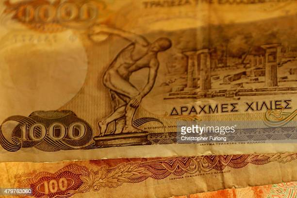 A man holds Drachma notes the currency in Greece before the Euro on July 7 2015 in Athens Greece Greek Prime Minister Alexis Tsipras is working on...