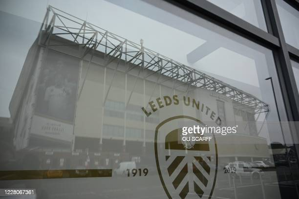 Man holds flags depicting Leeds United's Argentinian head coach Marcelo Bielsa, as he stands outside Elland Road stadium, the home ground of English...