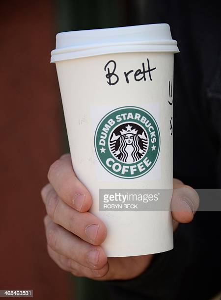 "Man holds his coffee drink outside ""Dumb Starbucks"" coffee shop, February 10 in the Los Feliz area of Los Angeles, CA. The store resembles a..."