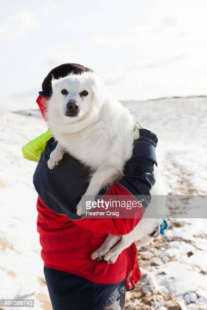 Man holds his dog