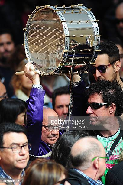A man holds his drum aloft during Holy Week celebrations on March 25 2016 in Calanda Spain
