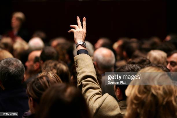 A man holds his hand up while bidding on a work of art inside the auction house Christie's during the PostWar and contemporary Art sale November 15...