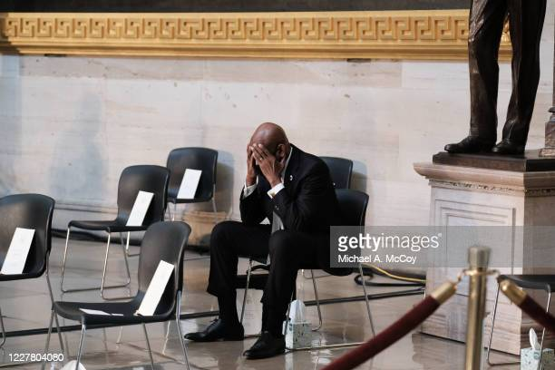 A man holds his hands on his head inside of the US Capitol Rotunda prior to a memorial to honor Rep John Lewis in Washington DC on July 27 2020 in...