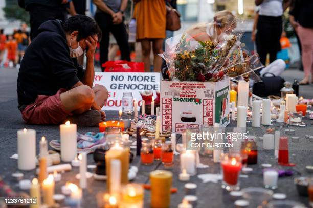 """Man holds his head as he attends an impromptu vigil at an anti-Canada Day event titled """"No Pride in Genocide"""" in Toronto, Ontario, Canada, July 1 to..."""