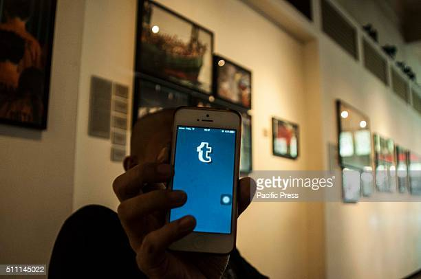 A man holds his mobile phone showing the Tumblr blogging website According to media reports the Indonesian Ministry of Communications announced that...