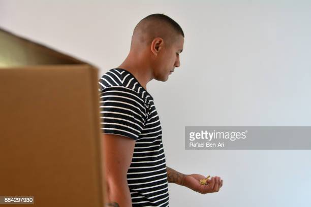 Man holds house keys during moving in or out home