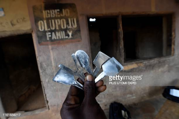 A man holds native instruments for tribal markings at the family compound of the Oloola Descendant Association traditional practitioners of tribal...