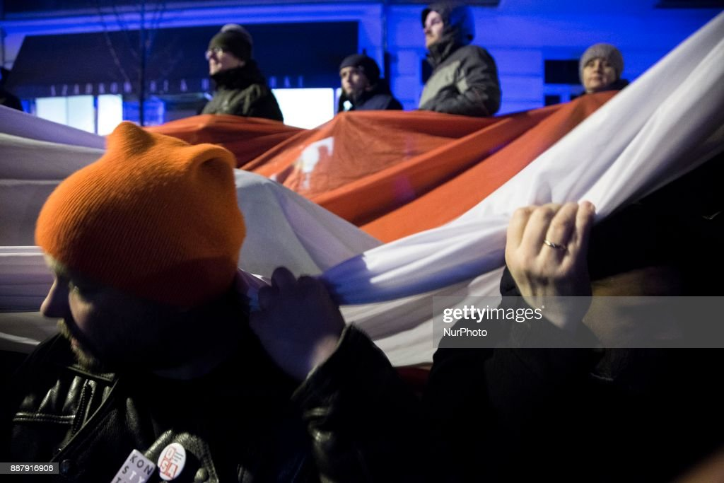 Man holds polish flag during illegal demonstration near Polish parliament organized by opposition group Obywatele RP in Warsaw on December 7, 2017.