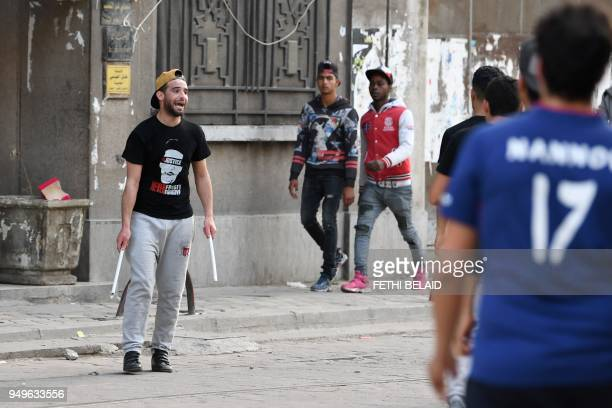 A man holds sticks as Club Africain fans demonstrate against the police they accuse of causing the death of a supporter in Tunis on April 21 2018 The...