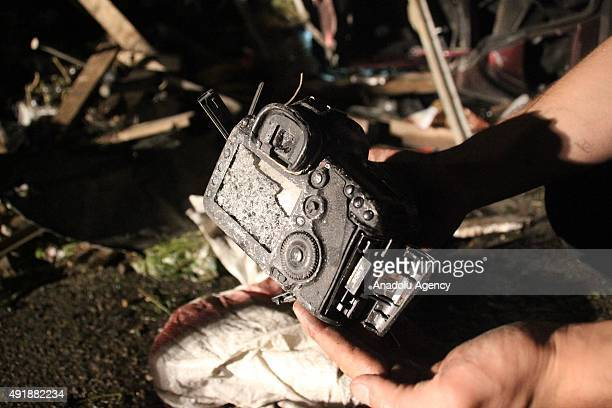 A man holds the DSLR camera of Anadolu Agency photographer Salih Mahmud Leyla who was killed after a car bomb exploded in Hireytan region of Aleppo...