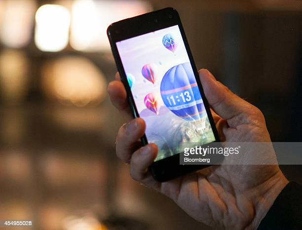 A man holds the new Fire smartphone by Amazoncom Inc during a demonstration at a news conference in Berlin Germany on Monday Sept 8 2014 Amazoncom...