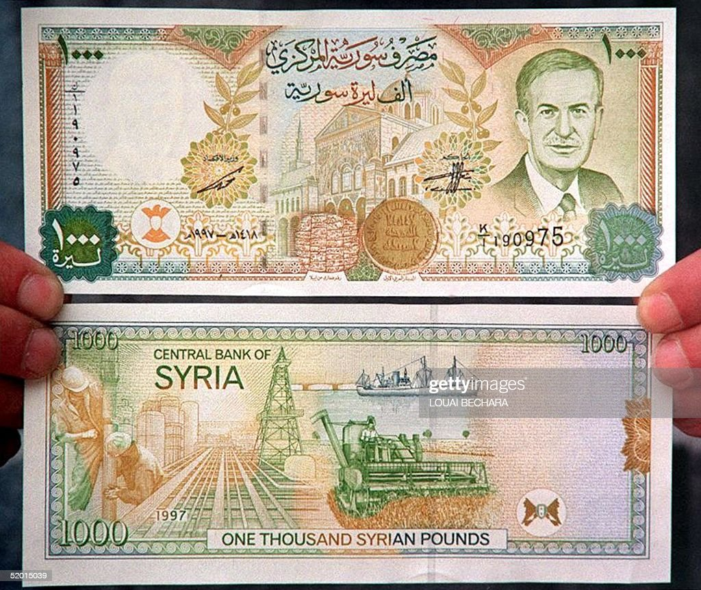 A Man Holds The New Syrian 1000 Pound