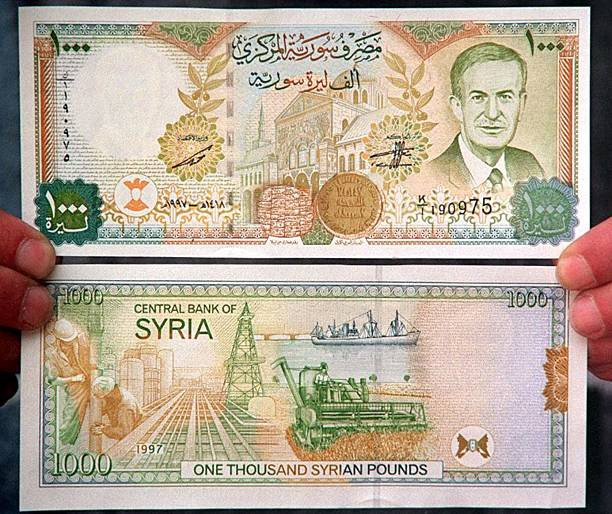 A Man Holds The New Syrian 1000 Pound Note Worth Pictures Getty Images