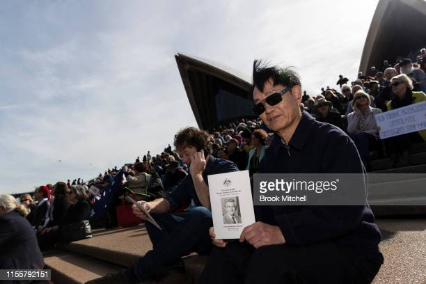 A man holds the order of service card at the Bob Hawke memorial at the Sydney Opera House on June 14 2019 in Sydney Australia Robert James Lee Hawke...