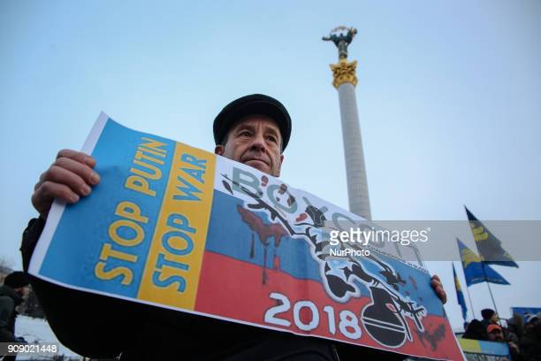 A man holds the placard during the quotStop Putin Stop warquot rally and quotKick Out Putinquot flashmob at the Independence Square in Kyiv Ukraine...