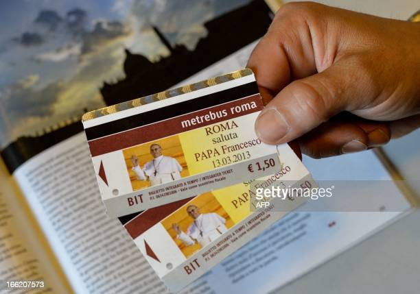 A man holds tickets of Rome's local public transport company ATAC showing a portrait of Pope Francis a few weeks after the election of Pope Francis...