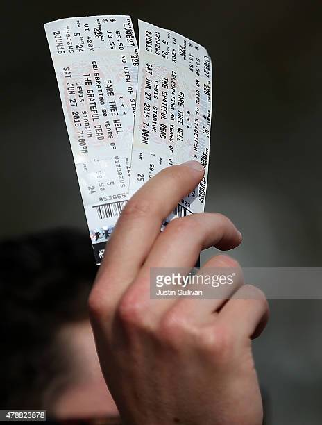A man holds tickets to the Grateful Dead show at Levi's Stadium on June 27 2015 in Santa Clara California The Grateful Dead is kicking off their 50th...
