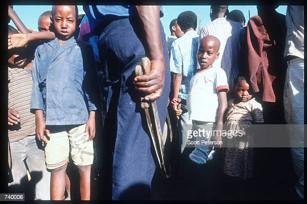 A man holds two machetes May 5 1994 in Rukara Rwanda Hundreds of Tutsis were killed at the Rukara Catholic mission April 1994 in one of the worst...