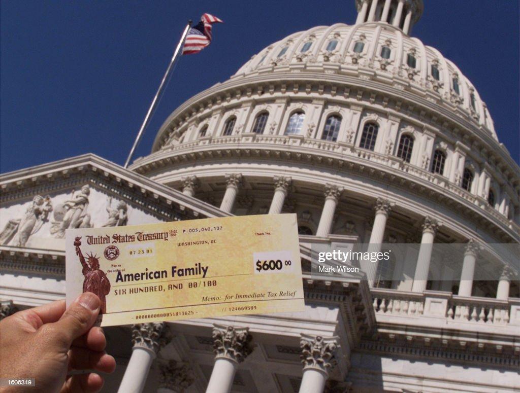 Tax Refund Checks Star of Republican Rally : News Photo