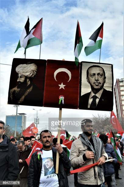 A man holds up a placard as proPalestinian protesters take part in a rally against US President Donald Trump's recognition the city of Jerusalem as...