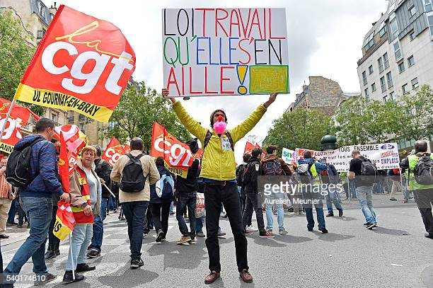 A man holds up a placard during an antilabour refom law demonstration on June 14 2016 in Paris France According to the police department around 80000...