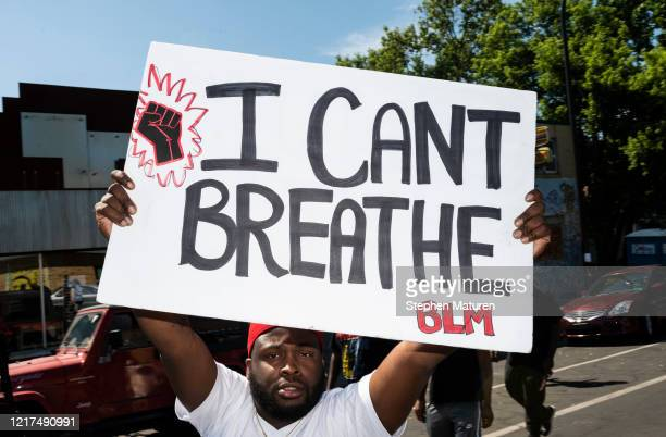 A man holds up a sign stating I Can't Breathe at a memorial for George Floyd on June 3 2020 in Minneapolis Minnesota Former police officer Derek...