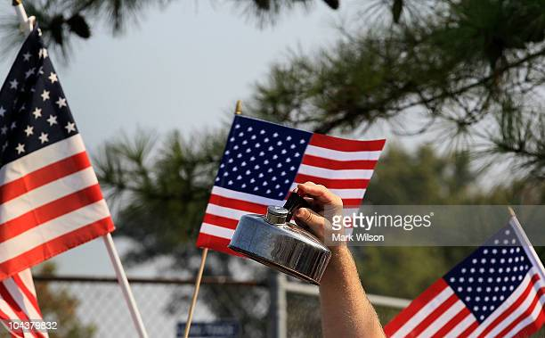 A man holds up a tea pot in front of the Tart Lumber Company where House Republicans held an event on September 23 2010 in Sterling Virginia House...